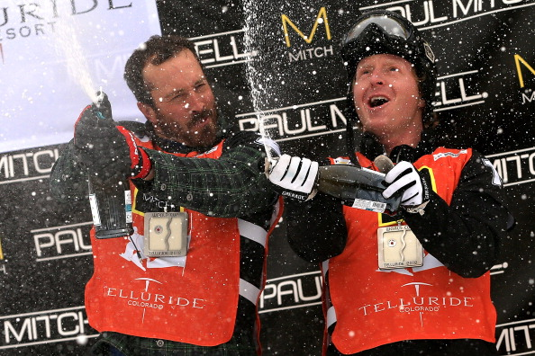 Seth Wescott and Nate Holland of the USA celebrate with champagne on the podium after winning the USANA Snowboardcross World Cup Team Event