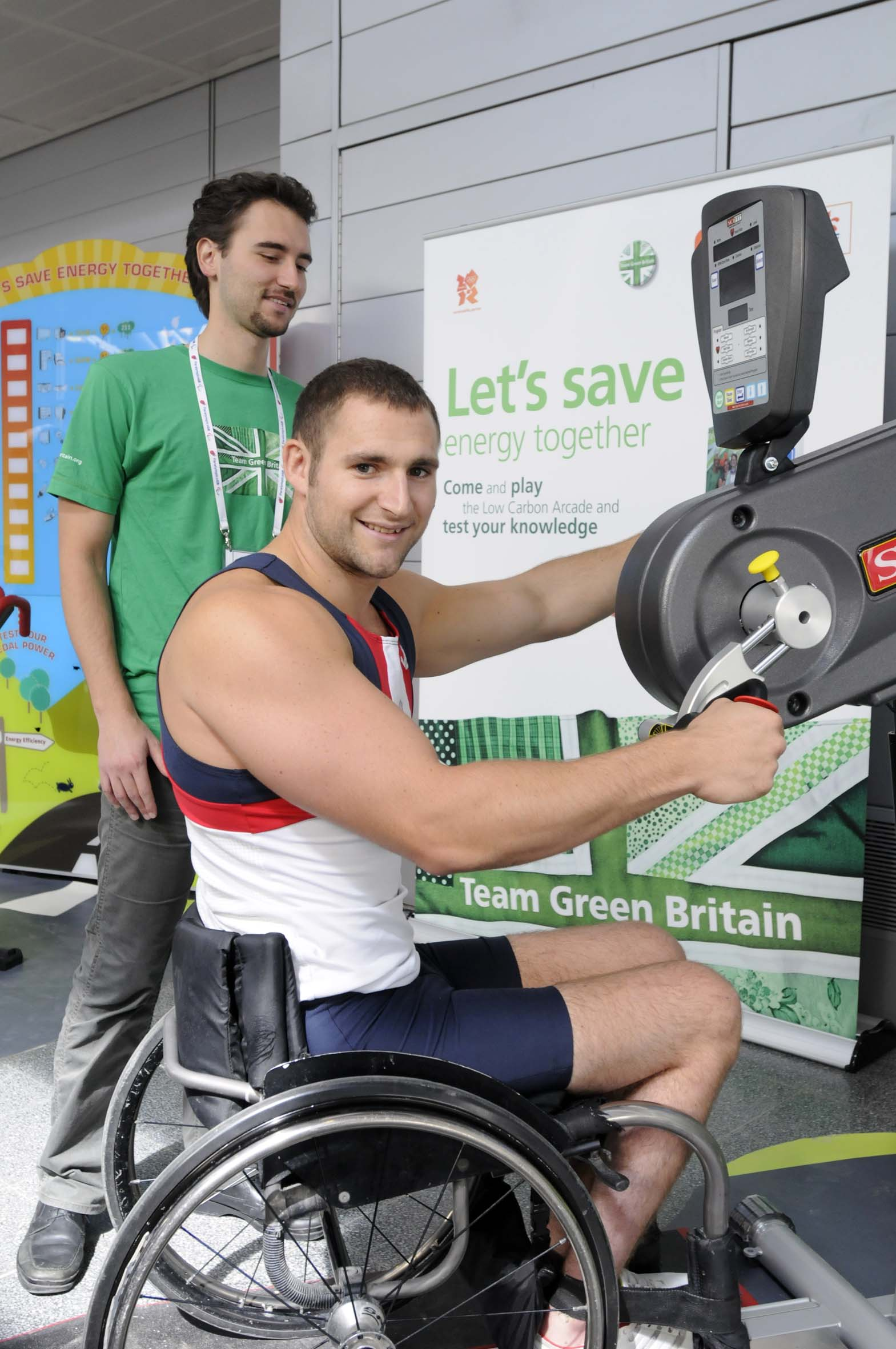 Tom Aggar gold medal winner in mens single scull rowing at the Beijing Paralympics demos the energy producing stationary hand cycle