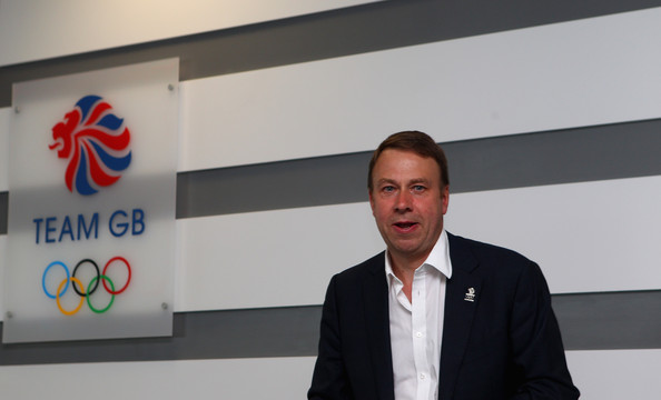 Andy Hunt in front of Team GB sign at London office