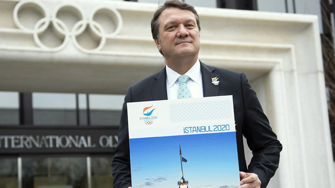 Hasan Arat with Istanbul 2020 poster outside IOC in Lausanne