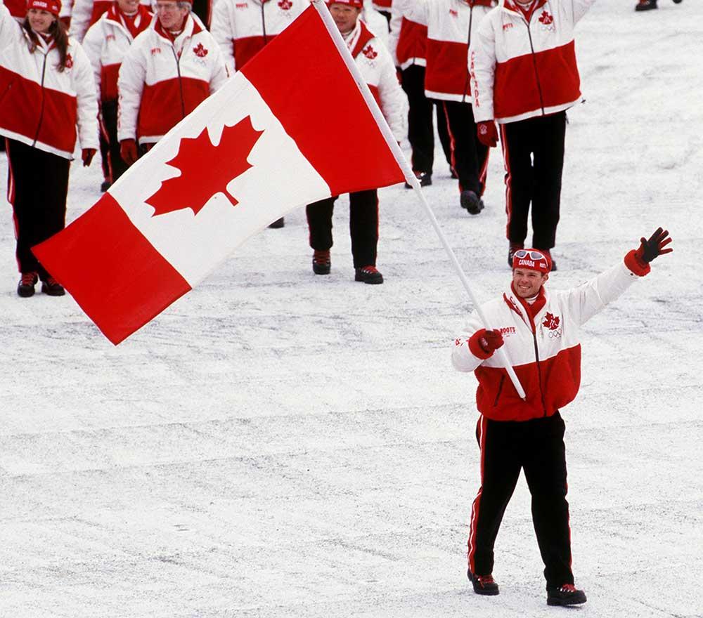 Jean Luc Brassard carrying flag Nagano 1998