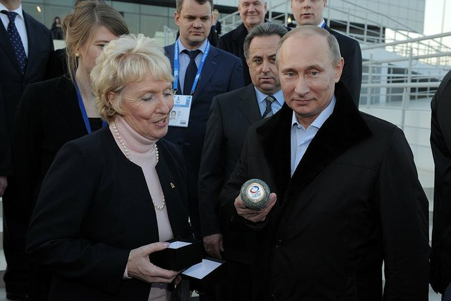 Kate Caithness and Russian President Vladimir Putin are shown around the Ice Cube Curling Centre