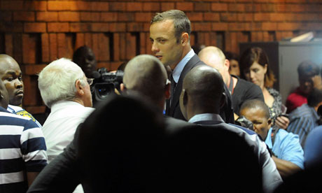 Oscar Pistorius leaves court in Pretoria after being formally charged with the murder of his girlfriend Reeva Steenkamp