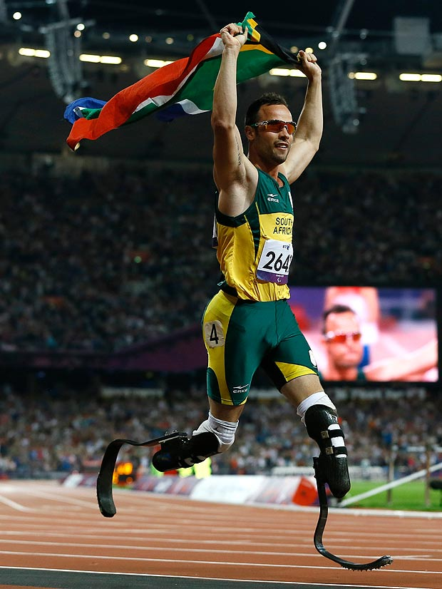 Oscar Pistorius with South African flag London 2012 Paralympics