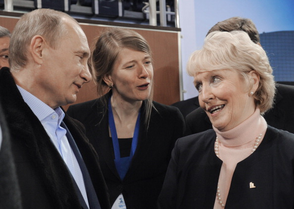 Russias President Vladimir Putin speaks with the World Curling Federation President Kate Caithness as they visit the Ice Cube Curling Centre
