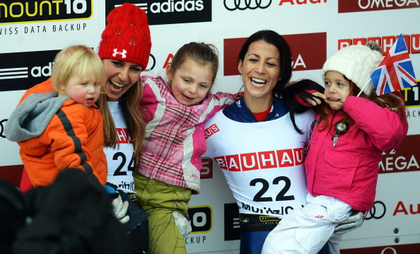 Shelley Rudman of Great Britain celebrates with her daughter Elli next to second placed Noelle Pikus Pace of USA