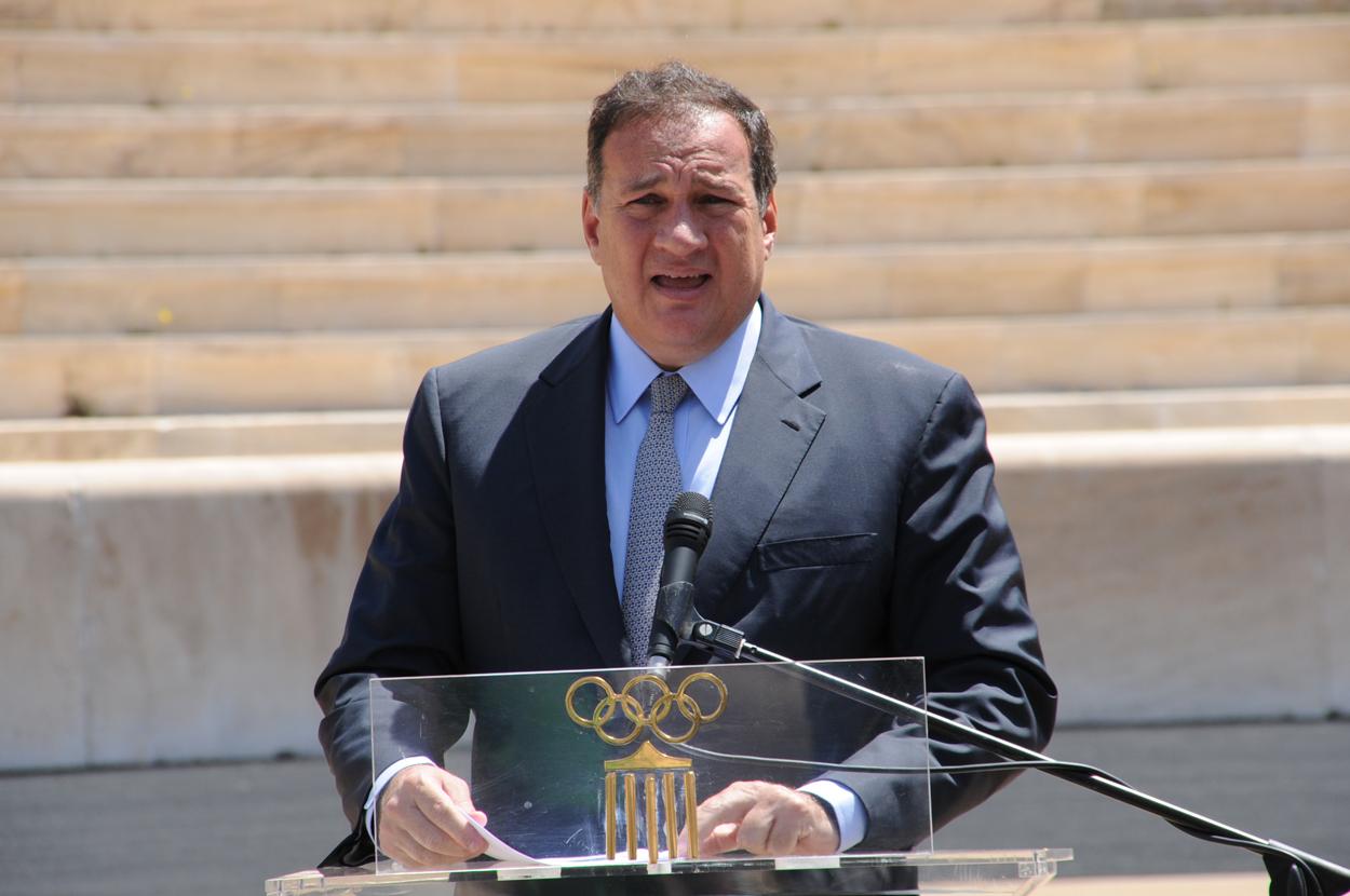 Spyros Capralos at podium