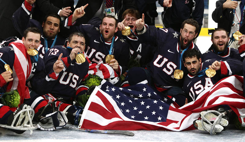 USA sledge hockey team celebrate gold medal Vancouver 2010