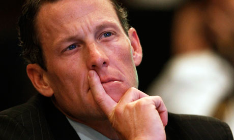 Lance Armstrong with fingers on lip