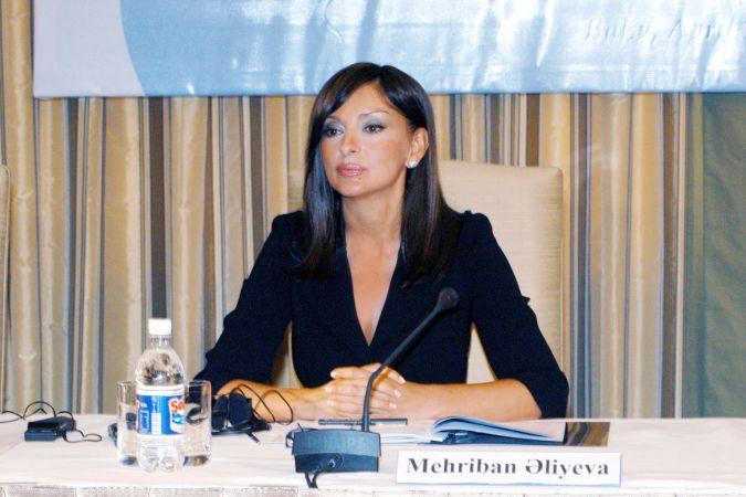 Mehriban Aliyeva behind name badge
