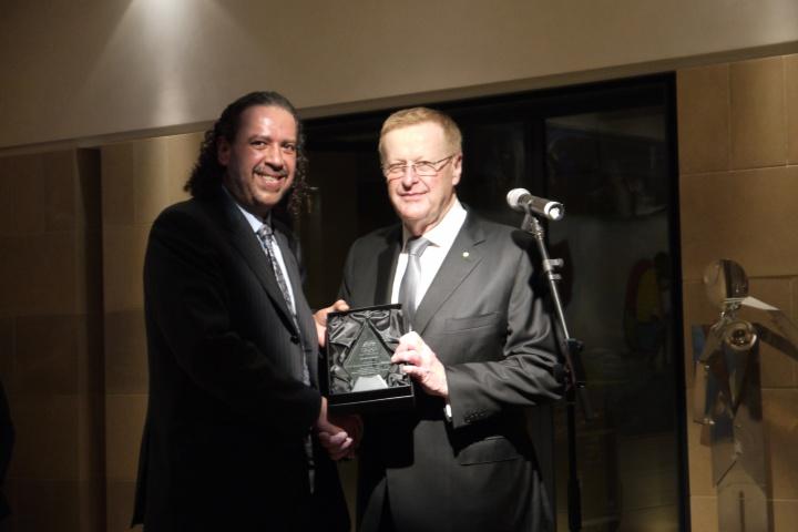 AOC President John Coates presents ANOC President Sheikh Ahmad Al-Fahad Al-Sabah with an Olympic Merit from the Australian Olympic Committee