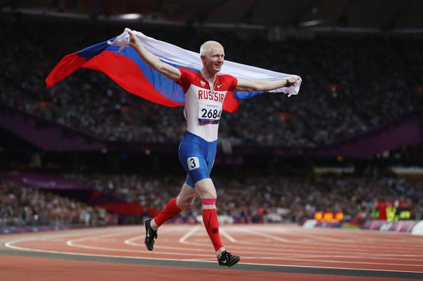Fedor Trikolich of Russia celebrates winning gold in the Mens 100m - T12 Final