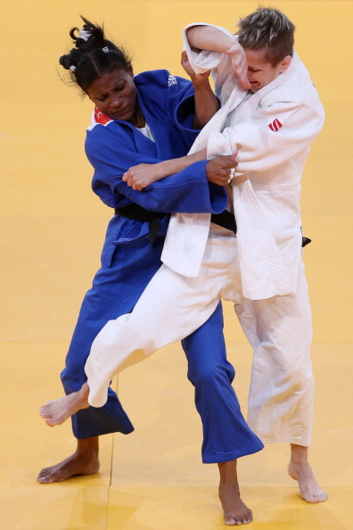 Ioulietta Boukouvala of Greece white competes with Yurileidys Lupetey Cobas of Cuba