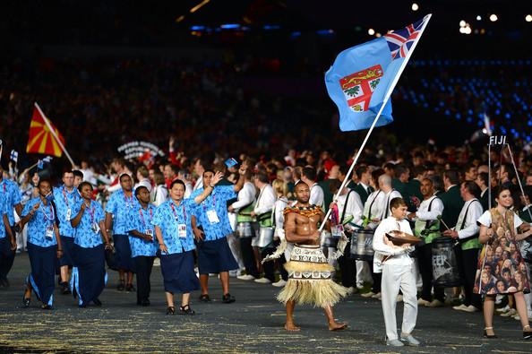 Josateki Naulu carrying Fiji flag at London 2012