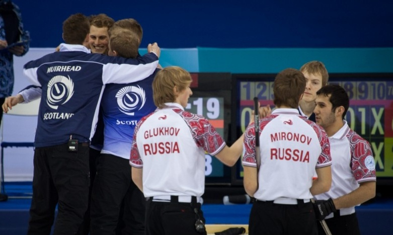 Scotland celebrate winning the 2013 junior world gold medal while Russia look on