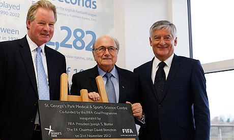 Sepp Blatter with David Bernstein being shown around St Georges Park