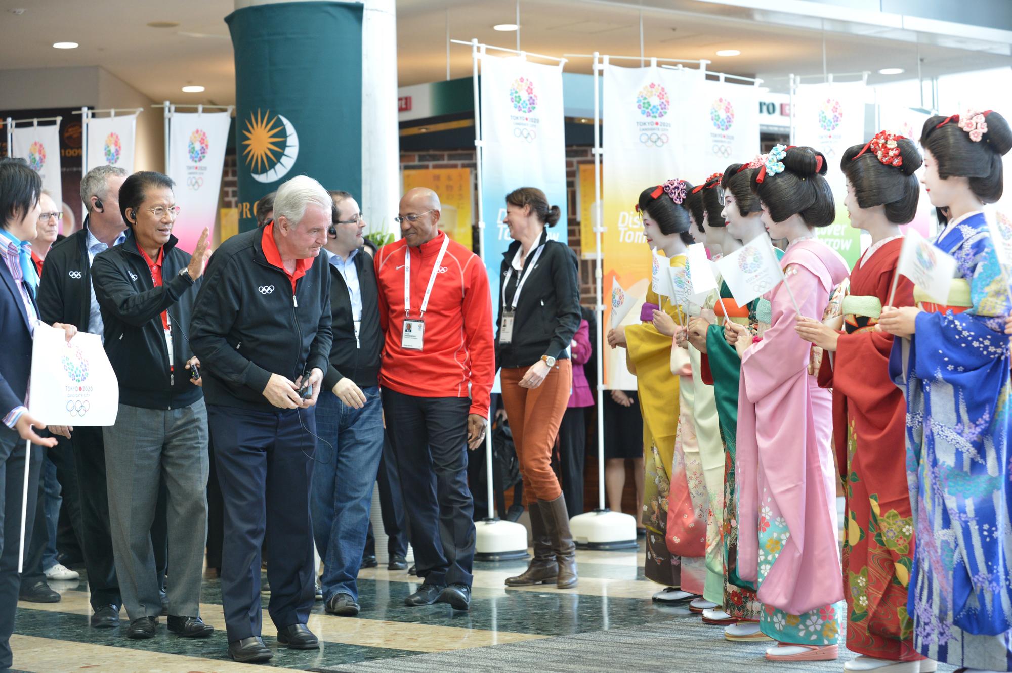 Sir Craig Reedie bowing at Tokyo Big Sight March 6 2013