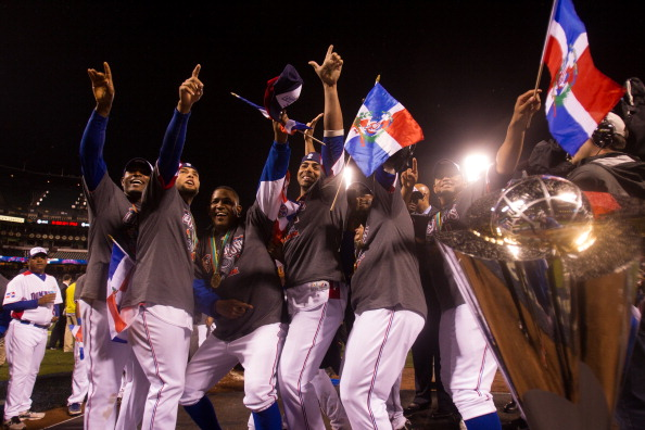 Team Dominican Republic celebrates on the mound after winning the 2013 World Baseball Classic Championship Game against Team Puerto Rico
