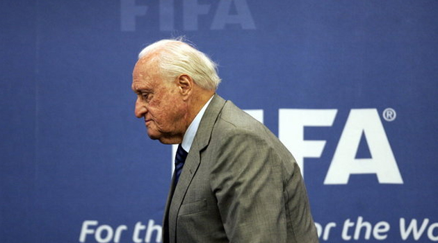 Joao Havelange in front of FIFA sign