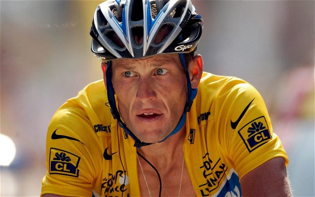 Lance Armstrong with yellow jersey zip down