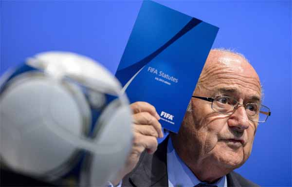 Sepp Blatter with FIFA statutes