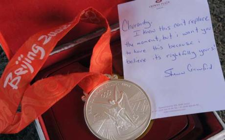Shawn Crawford gives medal away after Beijing 2008