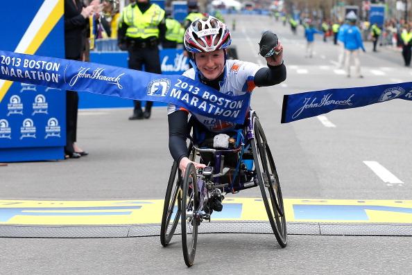 Tatyana McFadden crosses the finish line to win the womens wheelchair division of the 2013 Boston Marathon
