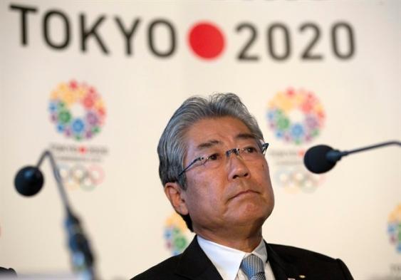 Tsunekazu Takeda in front of Tokyo 2020 logo