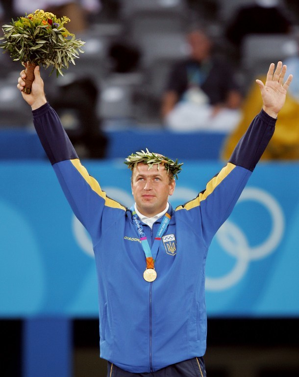 Yuriy Bilonoh celebrates winning the Olympic gold medal in the shot put at Ancient Olympia in 2004