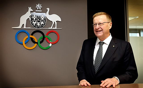 John Coates in front of AOC logo and Olympic rings