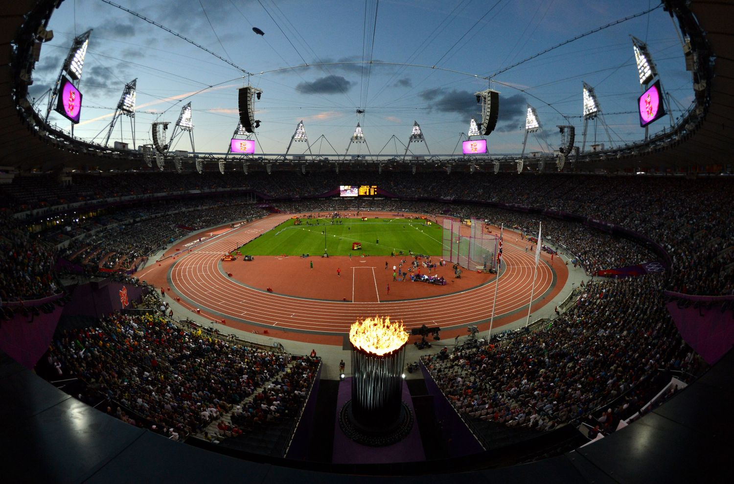 Olympic Stadium at night with flame
