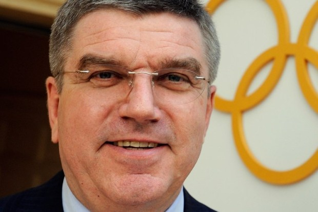 Thomas Bach in front of Olympic rings