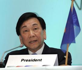 C K Wu behind Presidents name badge