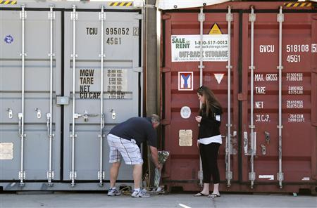 Flowers are placed by a storage container at the Artemis storage facility in California