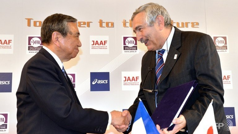 French Athletic Federation vice president Pierre Weiss R shakes hands with Yohei Kono president of the Japan Association of Athletics Federations in Tokyo on May 1 2013