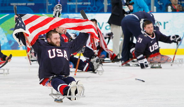 Taylor Lipsett celebrates his teams gold medal win at the Vancouver 2010 Winter Paralympics