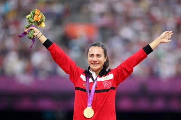 Asli Cakir Alptekin with Olympic gold medal