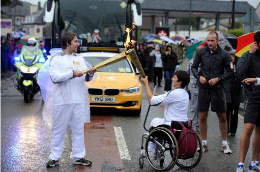 Emmanuelle Assmann carrying Olympic torch London 2012