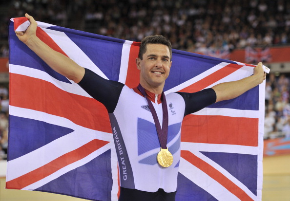 Britains Mark Lee Colbourne celebrates on the podium after winning the gold medal in the mens individual C1 pursuit final cycling event during the London 2012 Paralympic Games