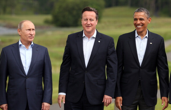 Russias President Vladimir Putin Britains Prime Minister David Cameron US President Barack Obama stand for the family group photograph at the G8 Summit