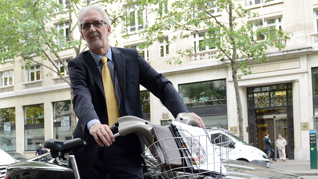 Brian Cookson on bike in Paris