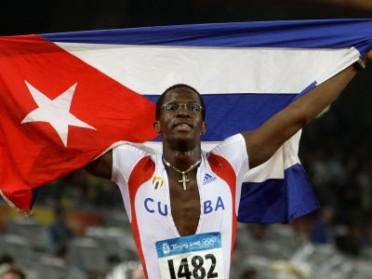 Dayron Robles with Cuban flag