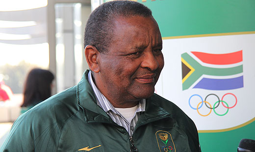 Gideon Sam in front of SA Olympic logo