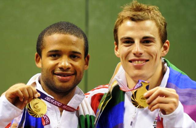 Adrian Grant left who will be competing in Rotterdam and doubles partner Nick Mathew celebrate Commonwealth Gold at Delhi 2010