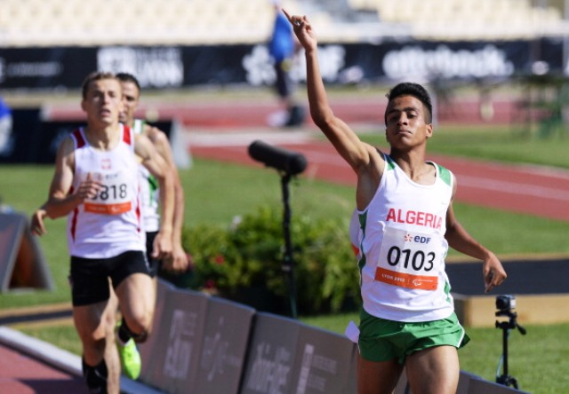 Algerias Abdellatif Baka crosses the line in Lyon to add the world title to his T13 800m Paralympic gold