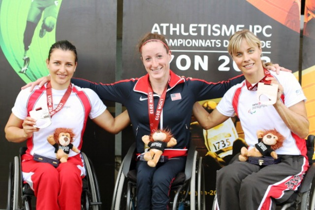 American Tatyana McFadden centre celebrates her third gold medal of the IPC World Athletics Championships following victory and a new world record in the T54 800m