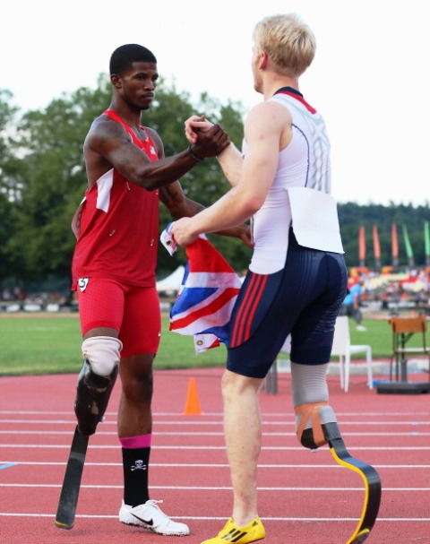 Great Britains Jonnie Peacock is congratulated by American Richard Browne following the mens T44 100m final in Lyon
