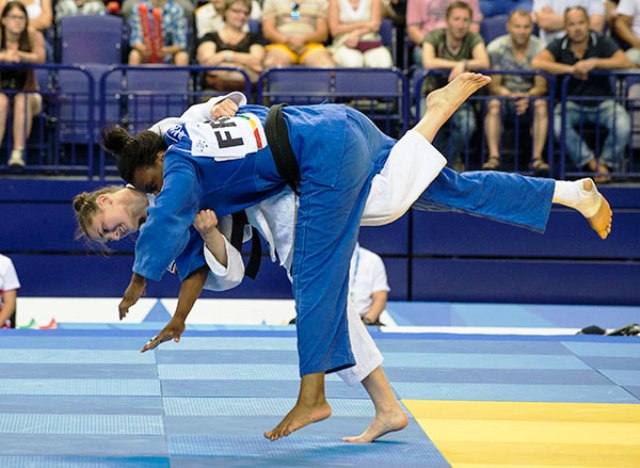Hungarian Abigel Joo gets the better of Madeleine Malonga of France in the final of the womens judo -78kg category at Kazan 2013