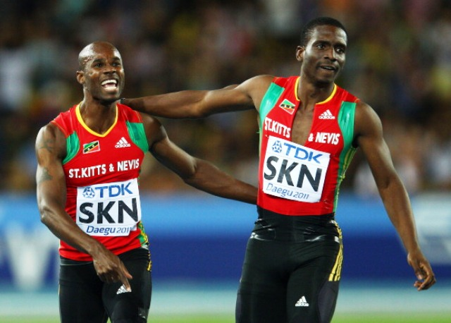 Kim Collins celebrates with teammate Jason Rogers of St Kitts and Nevis after securing bronze in the mens 4x100 metres relay final at Daegu 2011