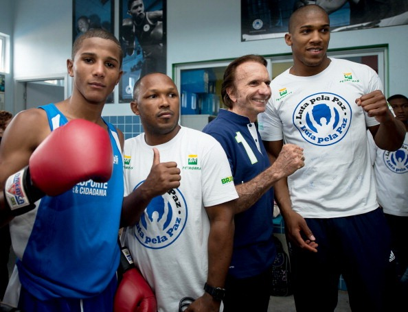 London 2012 gold medallist Anthony Joshua far right along with Formula One legend Emerson Fittapaldi at a Fight for Peace project in Rio de Janeiro